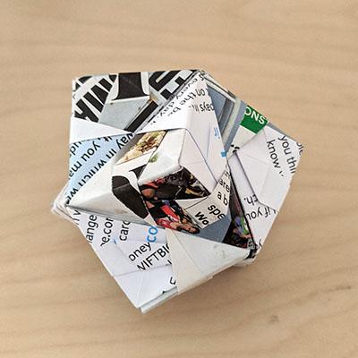 Photograph of a twelve-unit origami fold.