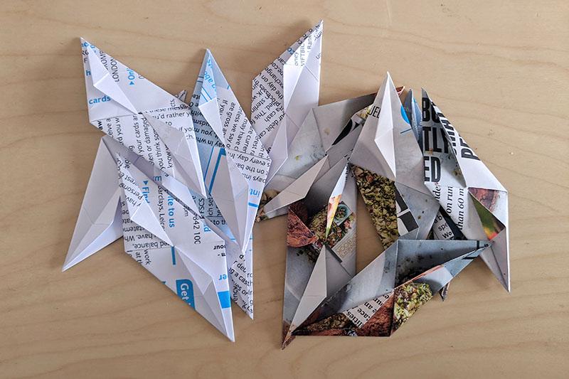 Photograph of twelve sonobe origami units.