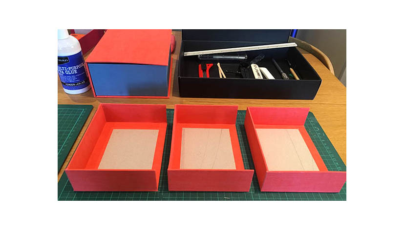 3 boxes, covered in book cloth