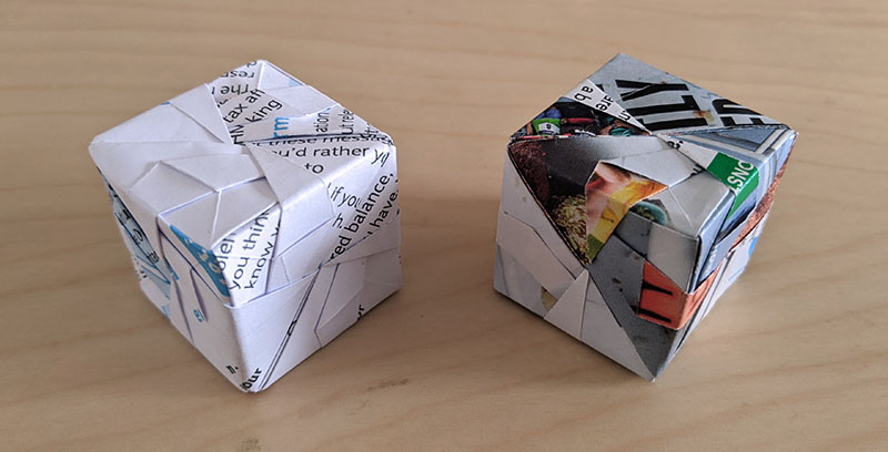 Photograph of origami cubes, made with found paper.