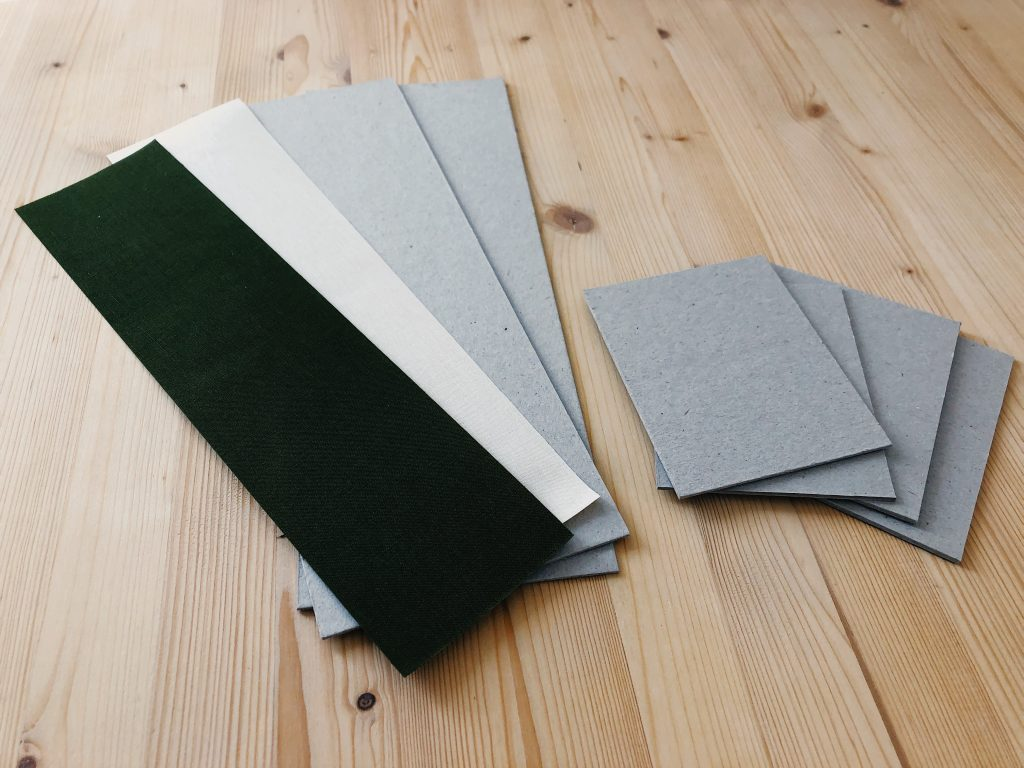 Showing book cloth and grey board