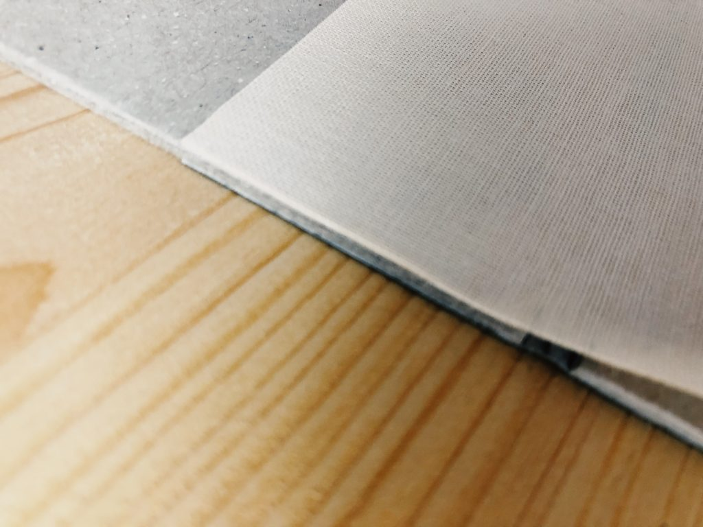 Image showing how to attach the book cloth
