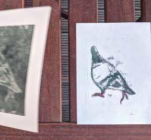 A print flying off my balcony as I try to take a photograph.