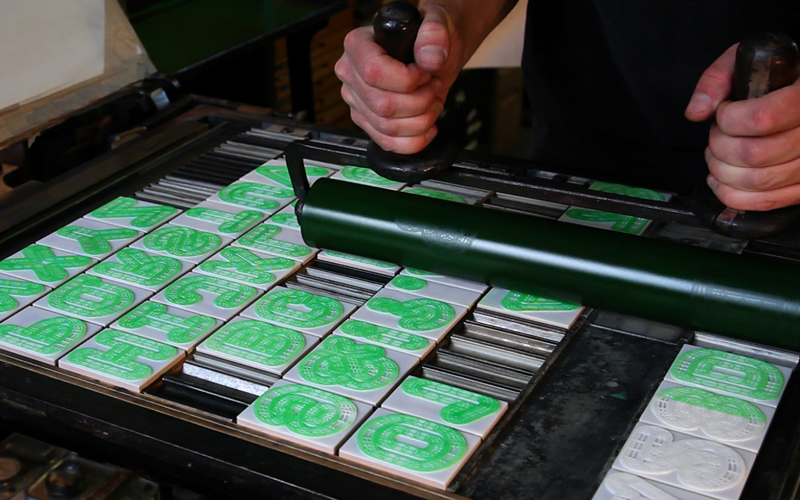 A23D letterpress setup, being inked in fluorescent green