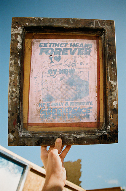 """image of a screen ready to print with Greenpeace slogan, """"extinction means forever"""" . ©photo by Alex Kurunis"""