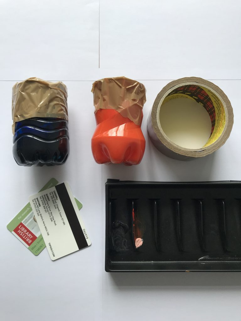 inks mixed in old plastic bottles, with tape, cards and mixing tray.