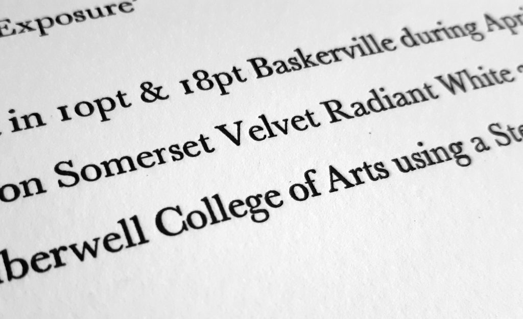 Letterpress printed text detailing the font and paper it was set in