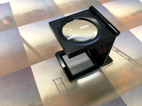 A 'loupe' or 'thread counter' or used viewing printed halftones