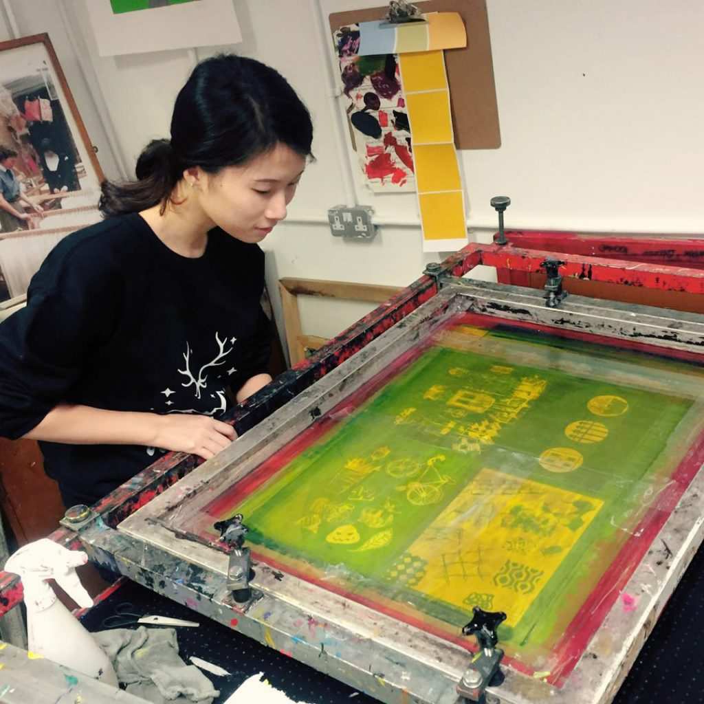 Photograph of the artist screen printing in the workshop at London College of Communication