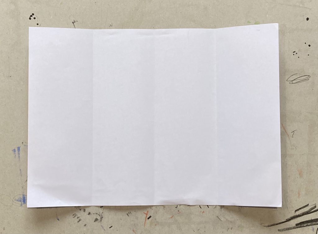 Piece of paper with folds width ways half way and then either side half of that.