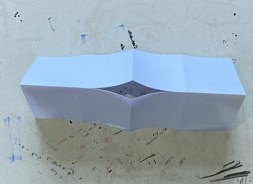 Image of paper with a cut through the middle.