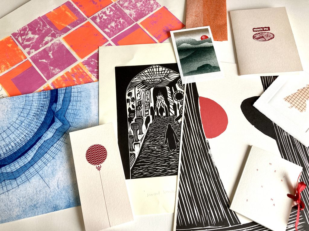 A collection of prints displayed on a table.