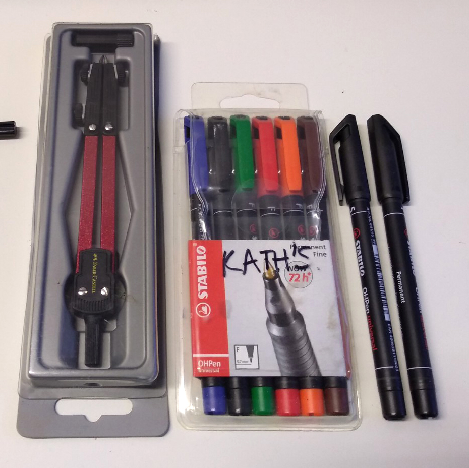 Permanent marker pens and compass