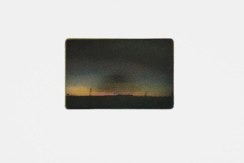 Small landscape image with rounded corners. The images shows a four colour photo etching of dark grounds with a sunset.